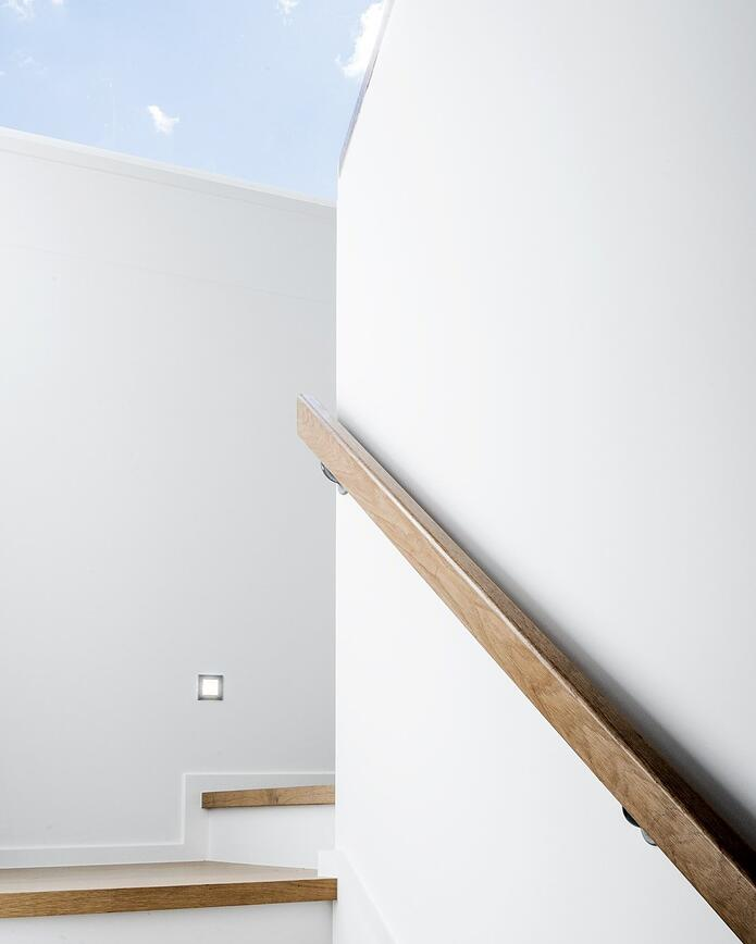 Brisbane luxury home builder Kalka | two storey staircase in Manly display home