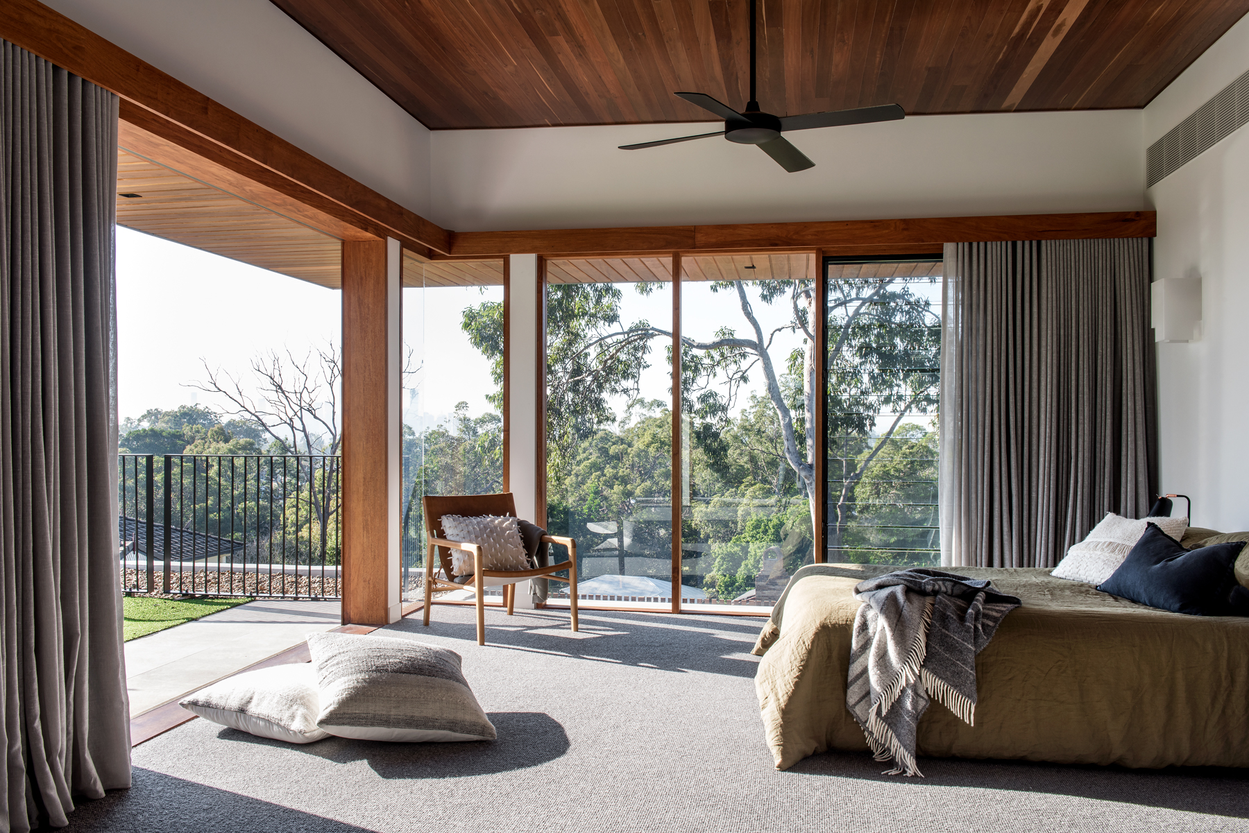 The Nest master bedroom suite featuring timber ceiling and glass windows, designed by Shaun Lockyer, built by Kalka, photographed by Cathy Schusler.