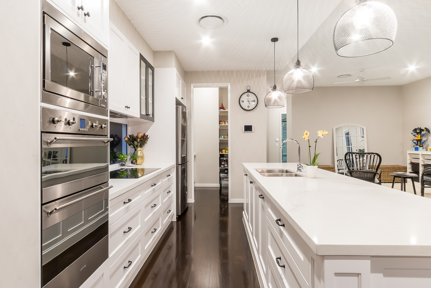 Hamptons style kitchen with timber floor by Kalka