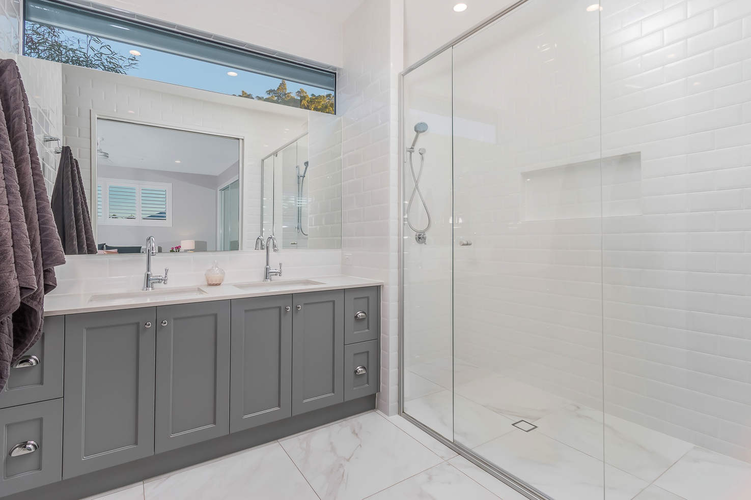 Hamptons style bathroom with shower and vanity by Kalka