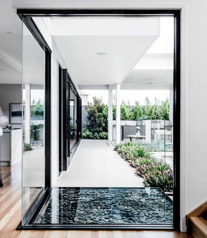 Queensland custom home builder Kalka | Glass entrance at Rochedale display home
