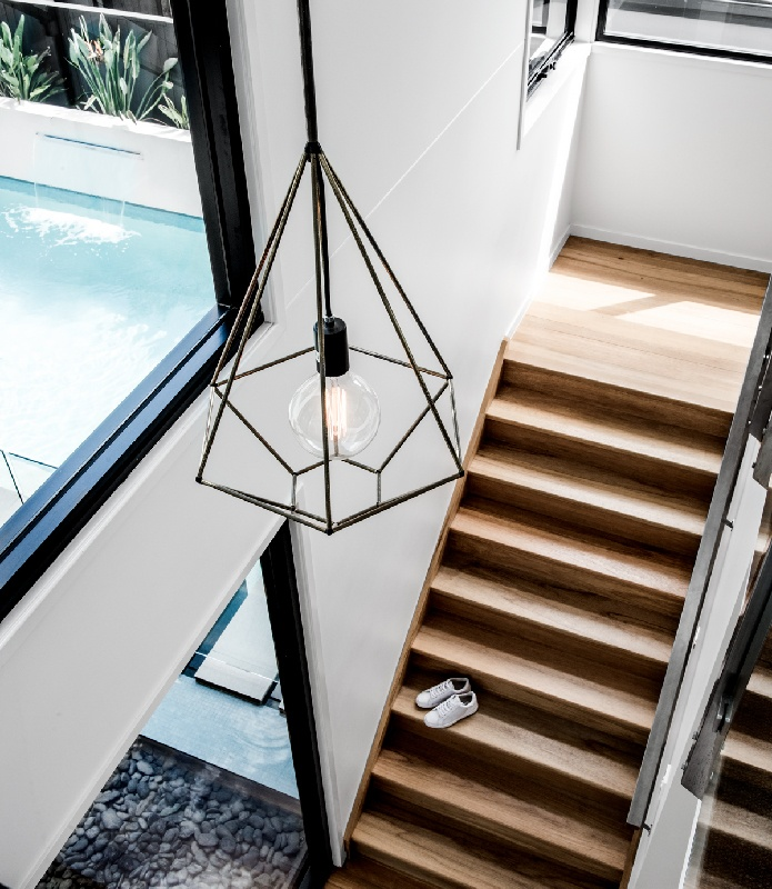 Gold coast luxury home builder Kalka | staircase with architectural pendant light in Rochedale Brisbane
