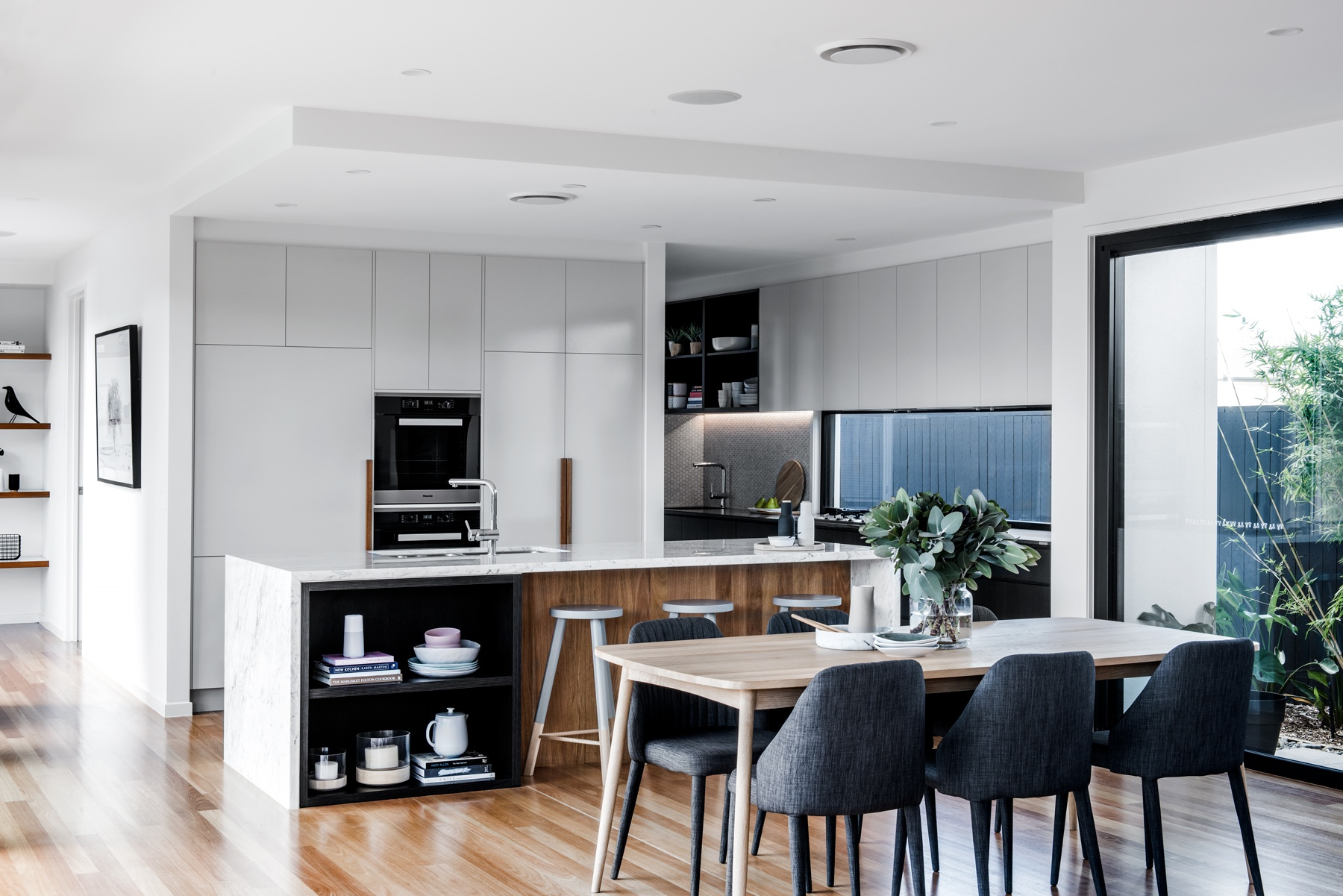 Contemporary kitchen featuring laminate cupboards and doors with various finishes and colours. Kitchen designed and built by Kalka.