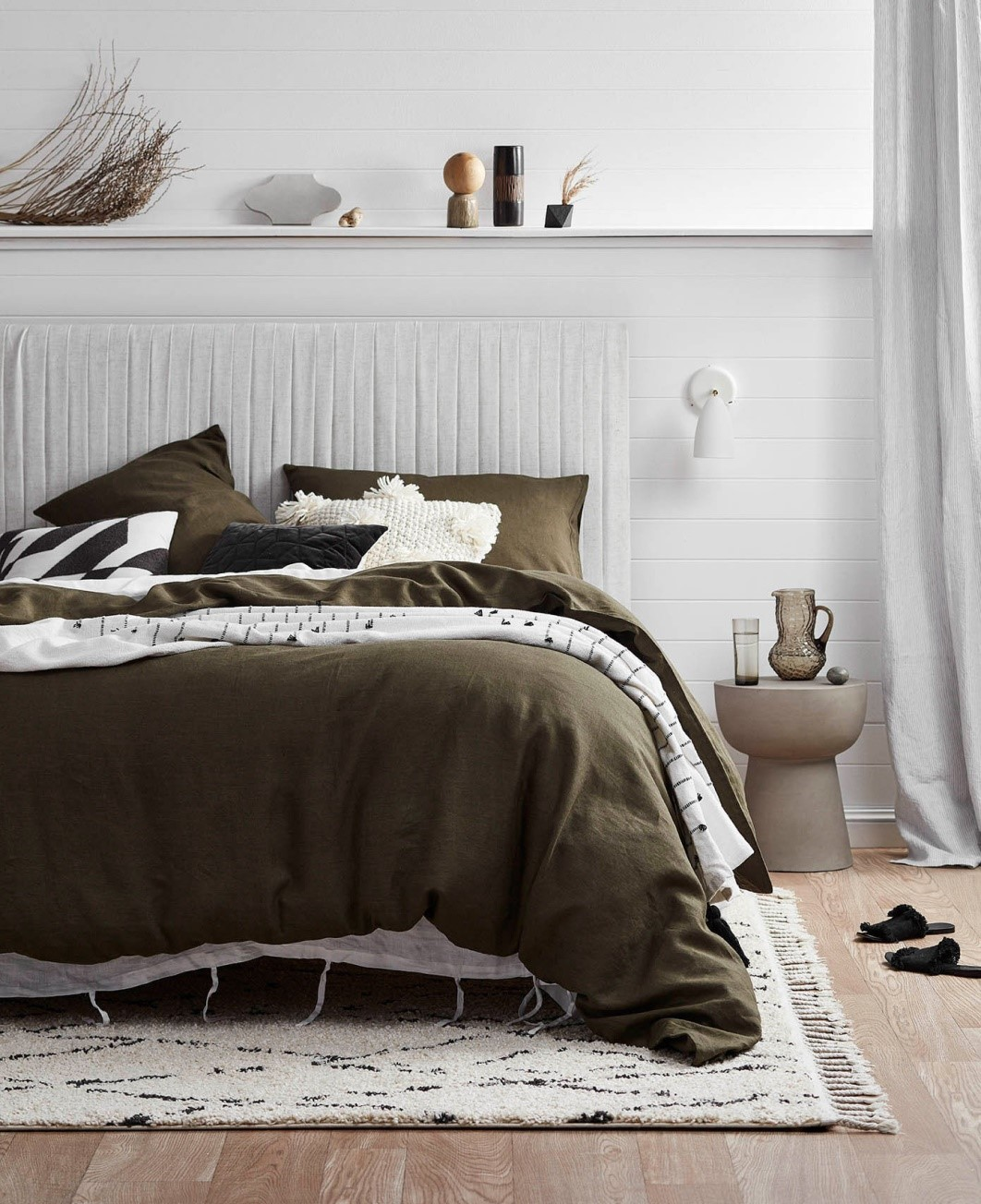 Country Bedroom featuring bed with olive linen by Temple & Webster