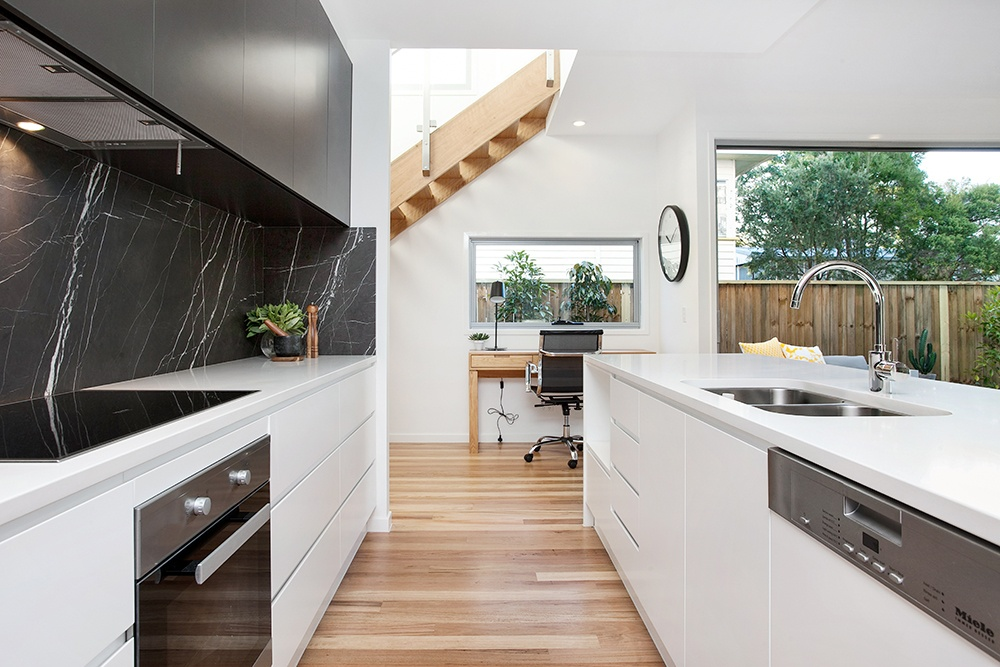 Modern black and white kitchen designed and built by Kalka.