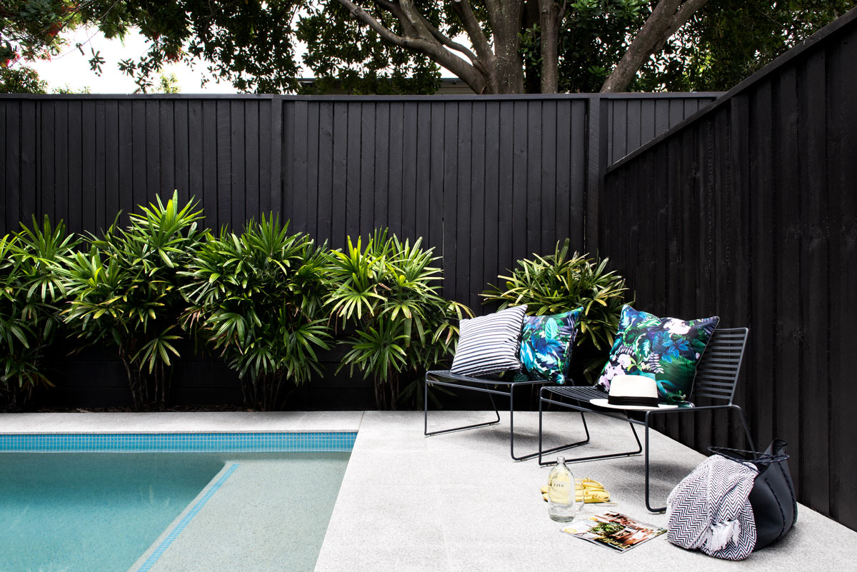 Gold Coast custom home builder Kalka | Outdoor pool with lounge chairs | Wooloowin display home