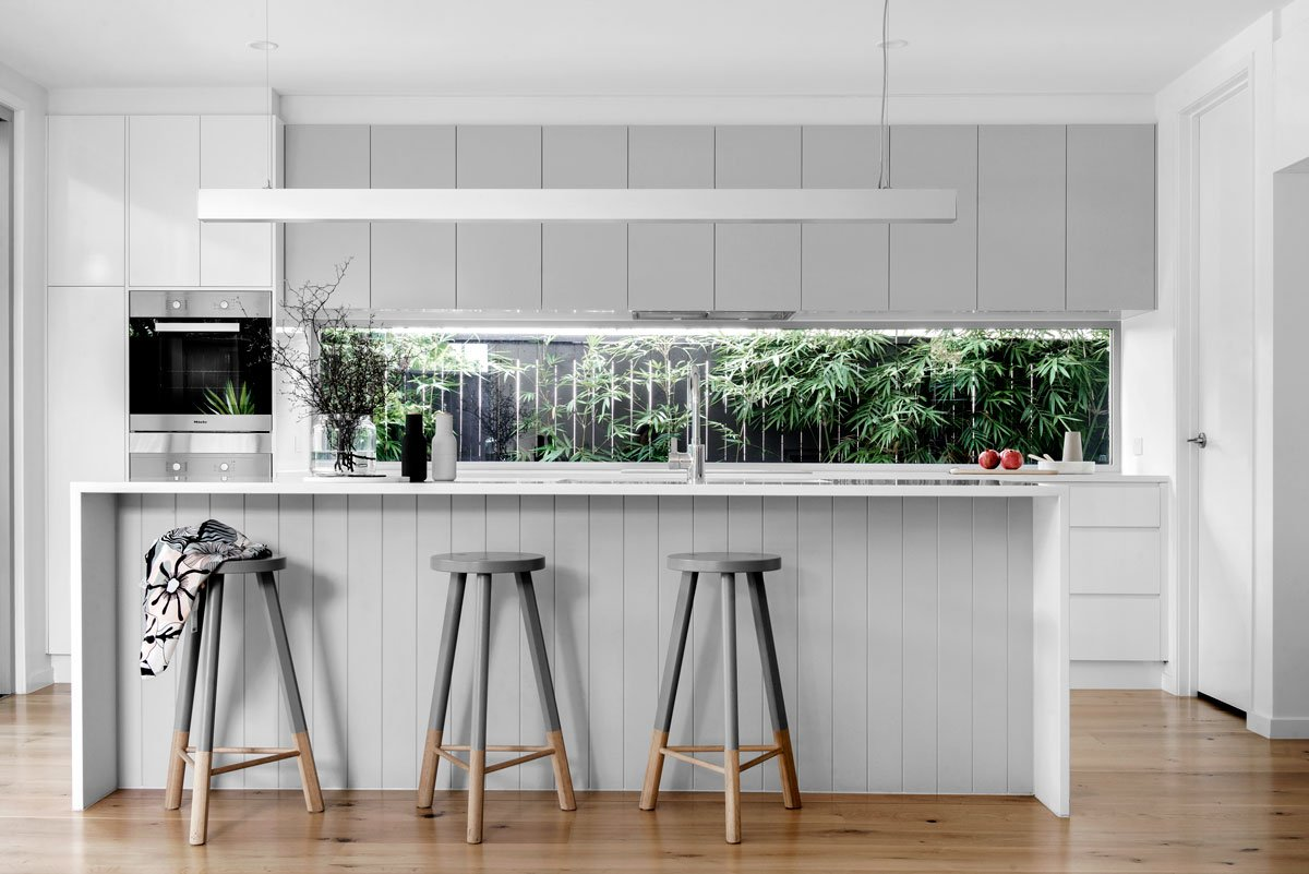 Modern Queensland style kitchen featuring 2PAC overhead cupboards, colour: Dulux Silkwort and white laminate under bench cupboards and drawers, colour: Polytec Natural White.
